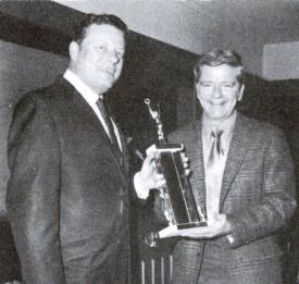Captain Preston Wheeler receiving an award from Chief David B. Gratz at an annual SSVFD Banquet at the Knight of Columbus on Rosensteel Ave - Circa 1960-61